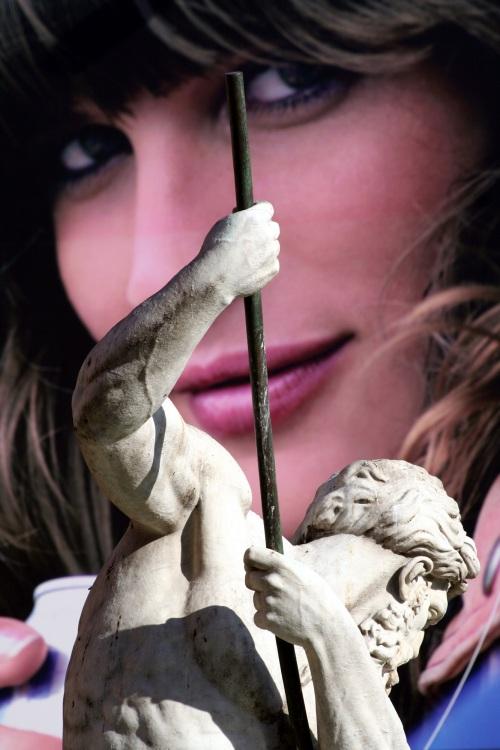 Bernini sculpture and advert hoarding, Piazza Navona