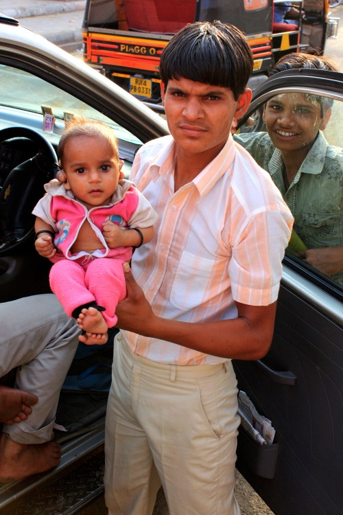 Young Man with Baby, Jaipur, March 21, 2010