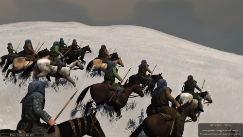 Riders in the snow, moving to flank