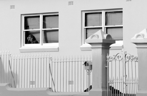 2352 Lady in window B & W